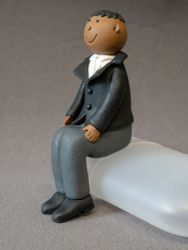 Claydough Black Haired Groom sitting LA4009